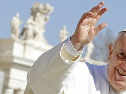 Francis waves as he leads the weekly audience in Saint Peter's Square at the Vatican