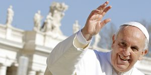 Francis waves as he leads the weekly audience in Saint Peters Square at the Vatican